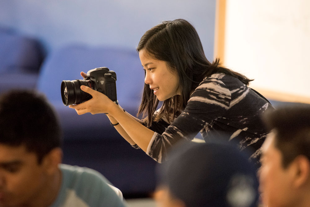 A student photographs an event