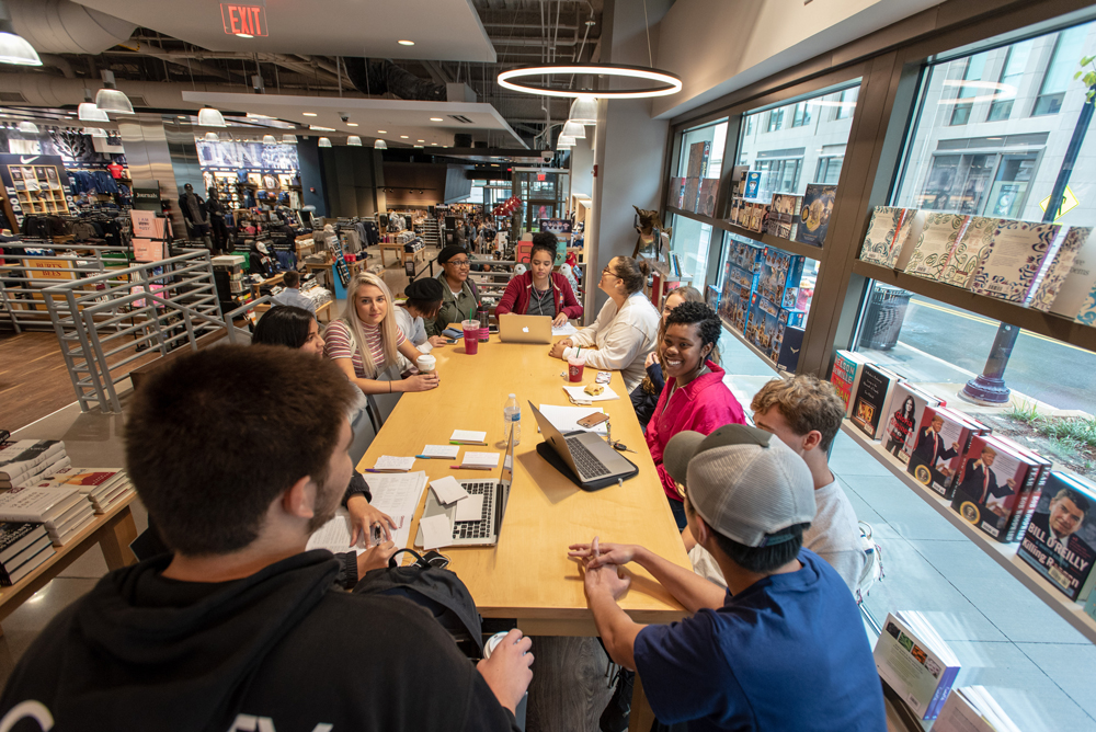 Students socializing at the Uconn Hartford Bookstore and Starbucks