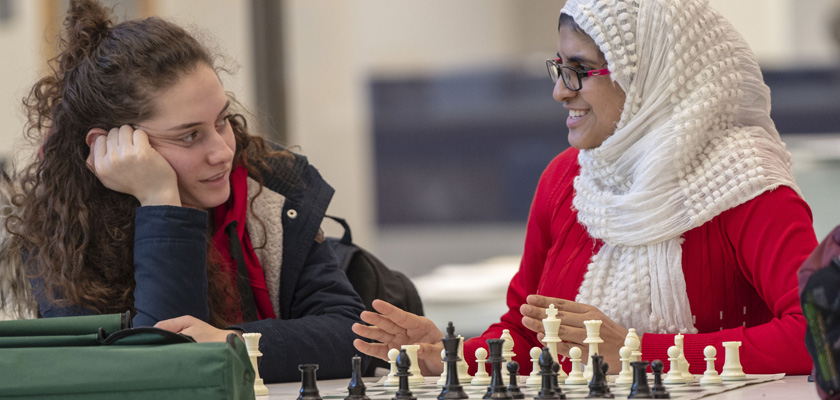 Two female students playing chess in hartford